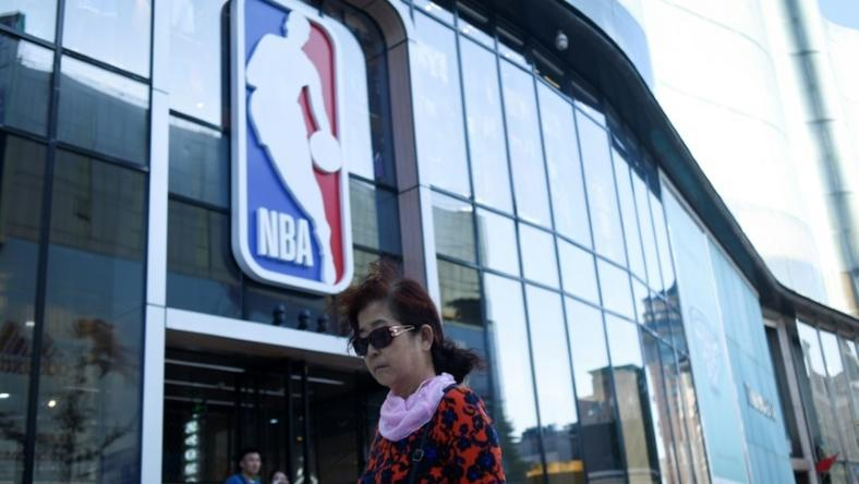 A bipartisan group of eight US lawmakers on Wednesday urged NBA commissioner Adam Silver to suspend all league activities in China until a sponsor and telecast boycott ends, which would close such places as the NBA merchandise store in Beijing