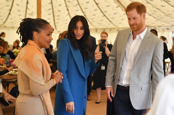 Dorija Regland sa Megan Markl i princom Harijem