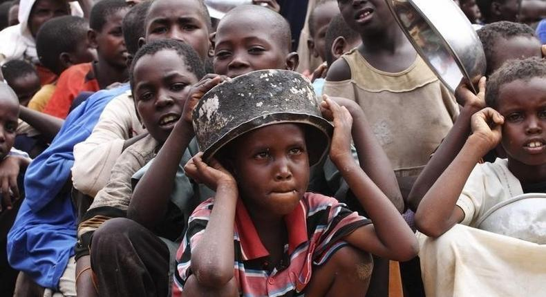 Internally displaced children queue for food supplies at the Badbado refugee camp in the south of capital Mogadishu August 1, 2011. REUTERS/Omar Faruk