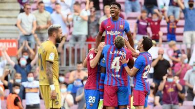 Fati returns in Messi shirt to help Barcelona ease pressure on Koeman
