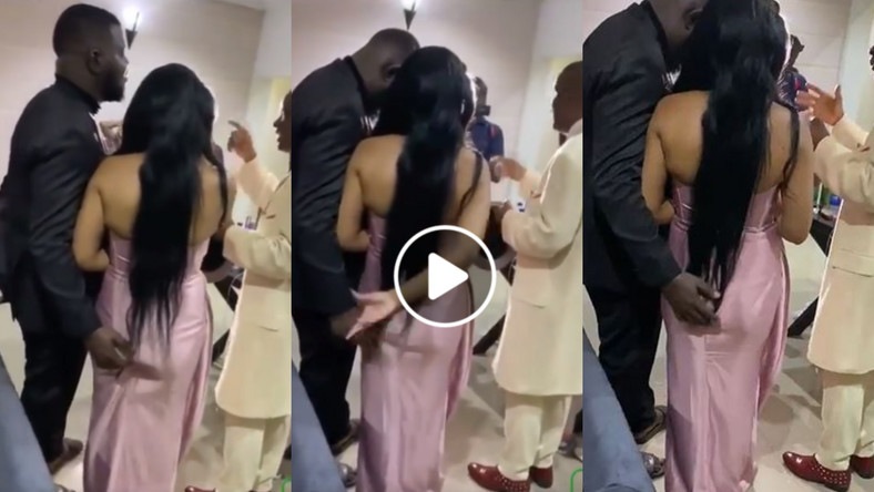 Groom captured in a video grabbing and playing with bride's ass while pastor prays for them