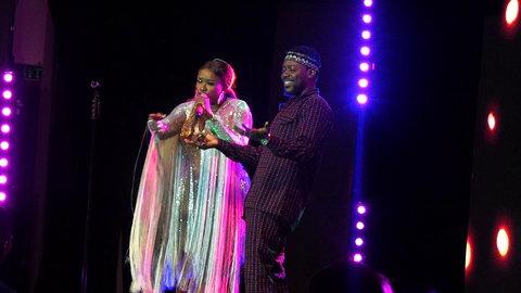 Waje on stage with Adekunle Gold at Red Velvet concert