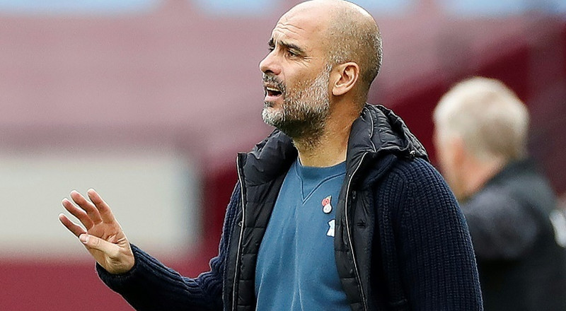 Guardiola downplays Liverpool clash, compares title race with US election
