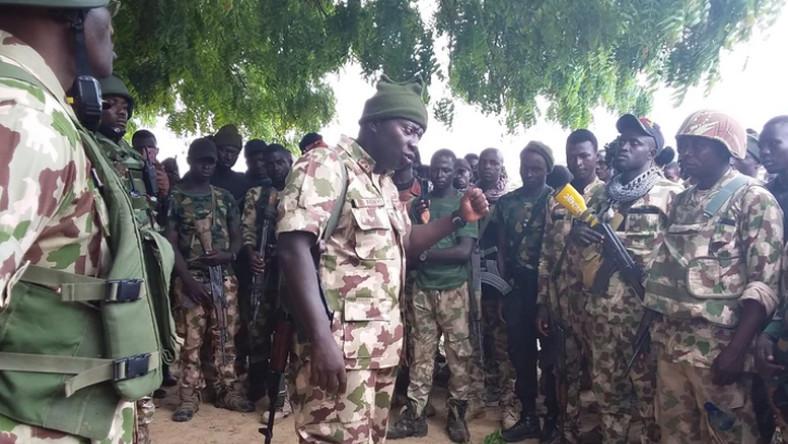 Maj.-Gen. Olusegun Adeniyi, the Theater Commander, Operation Lafiya Dole, addresses troops of the 5 Battalion, Gubio in Borno on Sunday [NAN]