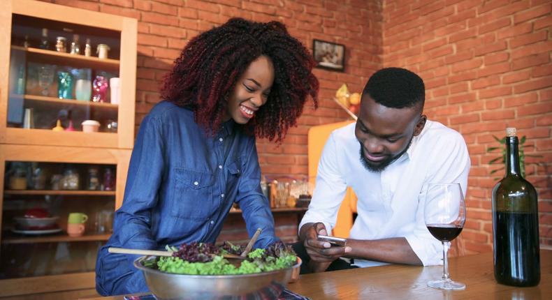 Cute couple in kitchen(Video Blocks)