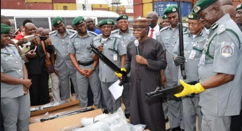 Customs boss, Hameed Ali with officers after seizing 661 pieces of riffles