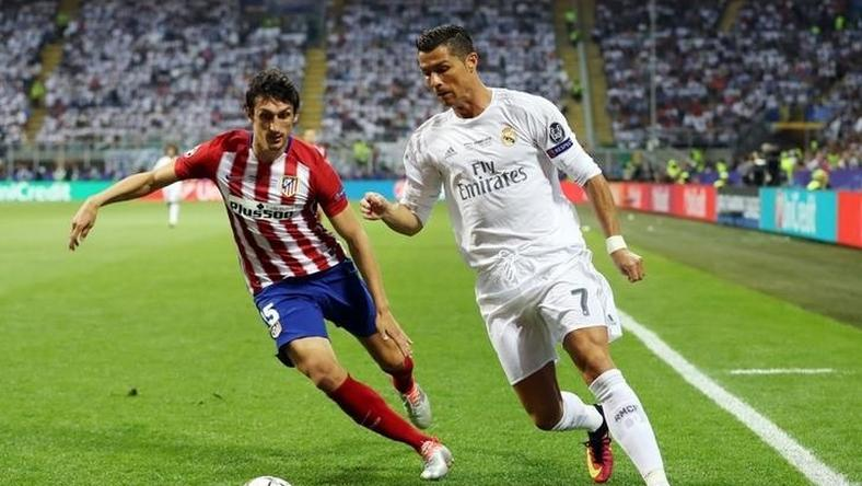 Soccer Football - Atletico Madrid v Real Madrid - UEFA Champions League Final - San Siro Stadium, Milan, Italy - 28/5/16 Real Madrid's Cristiano Ronaldo in action with Atletico Madrid's Stefan Savic