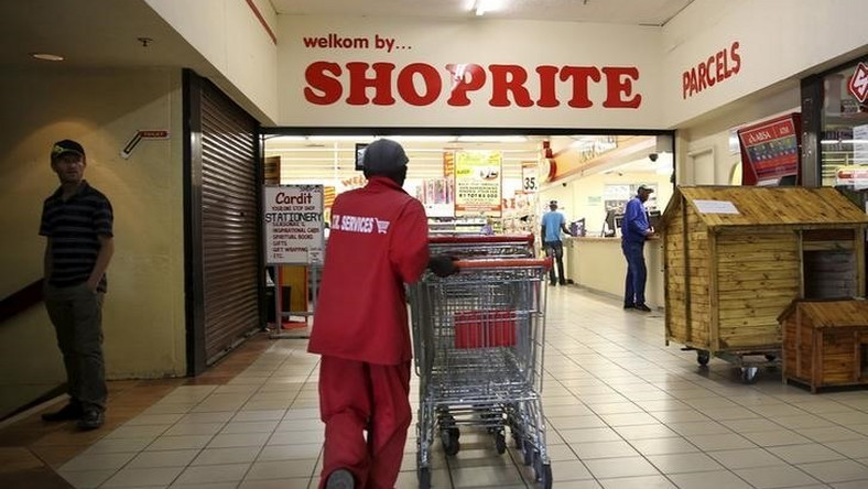 A worker pushing trolleys at Shoprite.