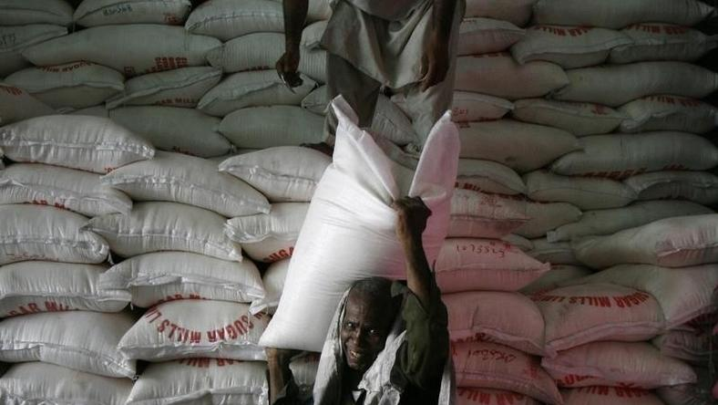 A man unloads a sack of sugar from a warehouse supply in Karachi April 10, 2010. REUTERS/Athar Hussain