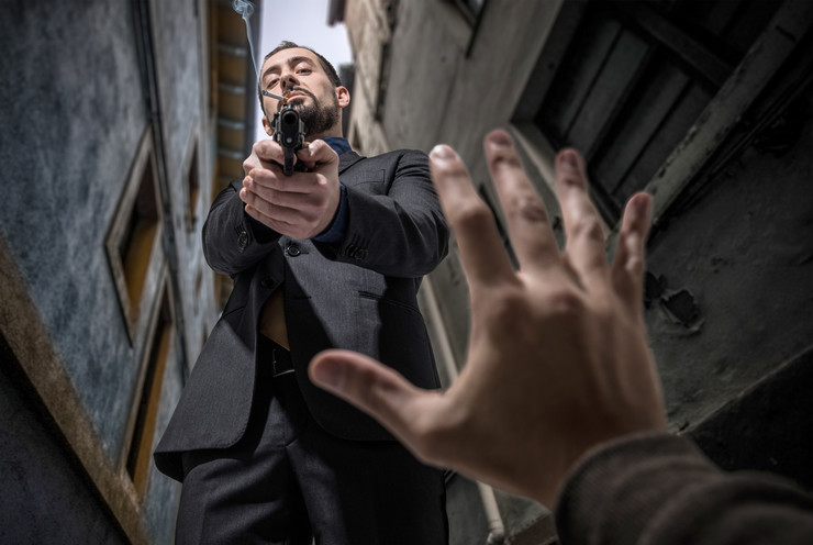 stock-photo-mafia-killer-murdering-an-innocent-572068303