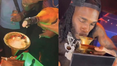 Burna Boy shows up in Nigerian club with Grammy plaque and drinks from it (WATCH)
