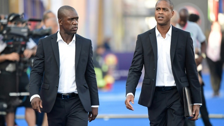 Clarence Seedorf and his assistant Patrick Kluivert arrive for the match against Nigeria in Africa Cup of Nations round of 16, their last in charge of Cameroon