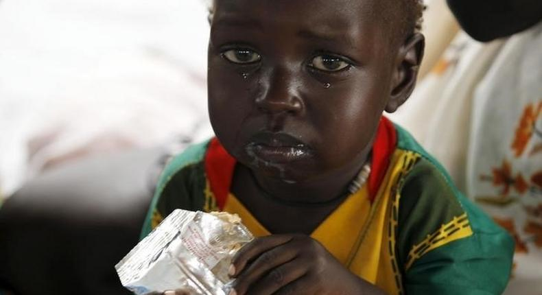 A refugee child from South Sudan feeds on food supplements at a health centre at the Kule refugee camp in Ethiopia's Gambella region, April 1, 2015. . REUTERS/Thomas Mukoya