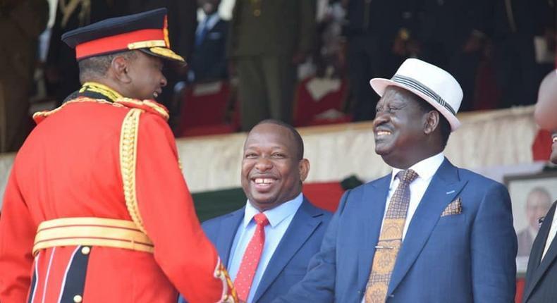 President Uhuru Kenyatta with former PM Raila Odinga during the Jamhuri Day celebrations