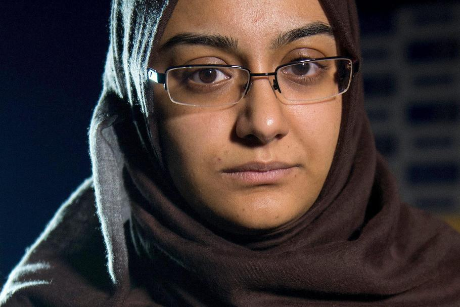 FILE PHOTO: Renu Begum, sister of teenage British girl Shamima Begum, holds a photo of her sister as