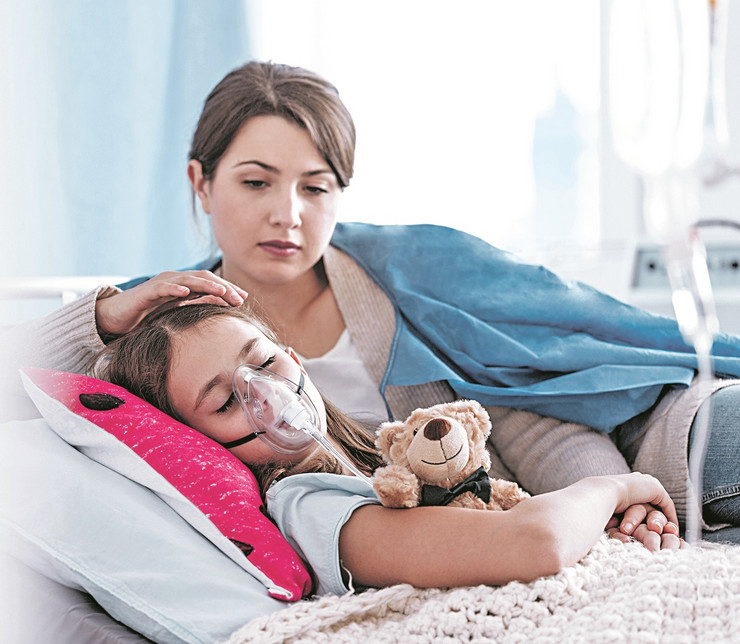 A stock-photo-worried-mother-taking-care-of-a-kid-with-cystic-fibrosis-lying-in-hospital-bed-with-plush-toy-1014875185