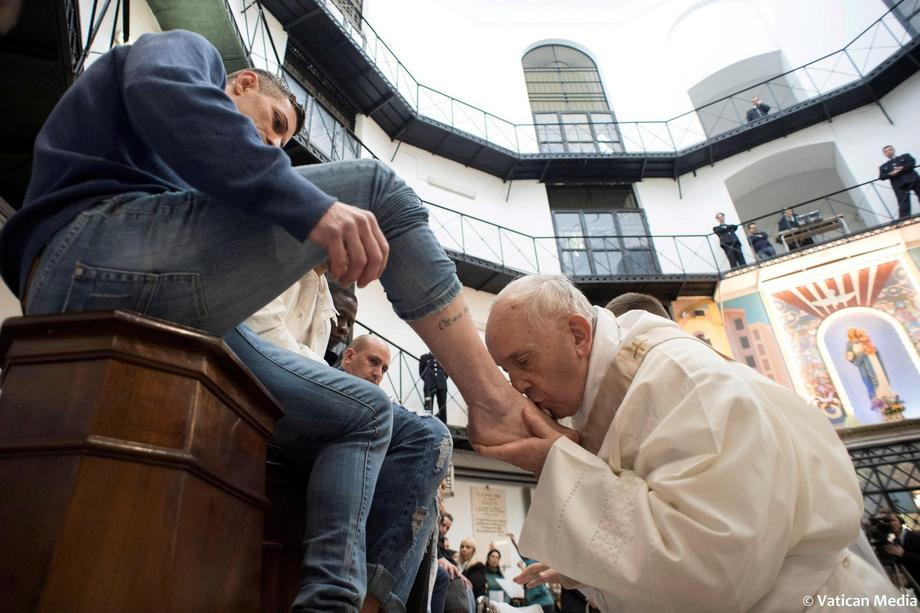 Pope Francis kisses the foot of an inmate at the Regina Coeli prison during the Holy Thursday celebr