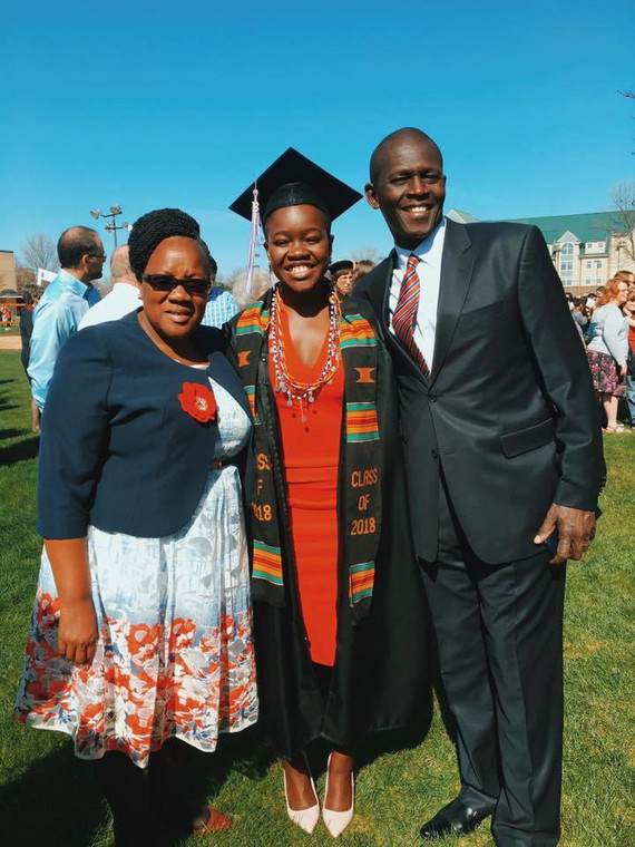 Achieng and her parents during her graduation in May 2018 (Facebook)