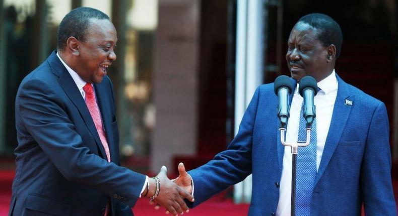 Uhuru Kenyatta with Raila Odinga during the 09 March handshake