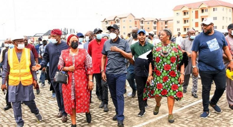 L-R: Permanent Secretary, Ministry of Housing; Mr Wasiu Akewusola; Commissioner for the Environment & Water Resources, Mr Tunji Bello; Special Adviser to the Governor on Works & Infrastructure, Mrs Aramide Adeyoye; Gov. Babajide Sanwo-Olu; General Manager, LagosHOMS, Mr Bayowa Foresythe; Special Adviser to the Governor on Housing, Mrs Toke Benson-Awoyinka and Senior Special Assistant on Housing, Mr Ayodeji Amodu, during an inspection of LagosHOMS Sangotedo Housing project in Eti Osa, on Friday, Sept. 17, 2021. (NAN)