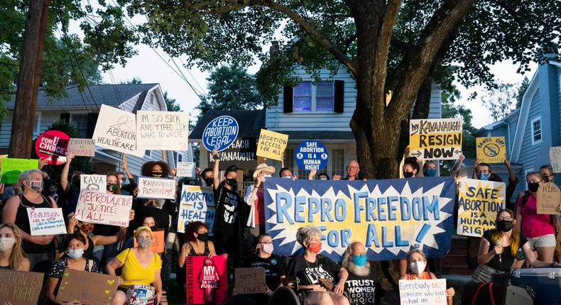 Protesters gather outside the home of Supreme Court Justice Brett Kavanaugh, Monday, Sept. 13, 2021, in Chevy Chase, Md.