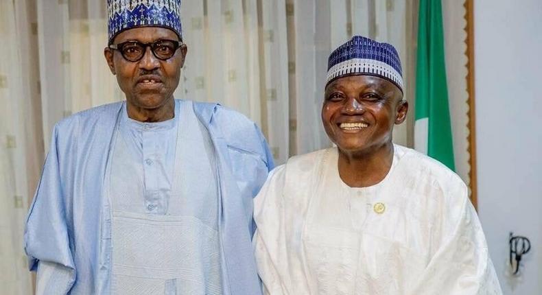 President Muhammadu Buhari (Left) felicitates with his Senior Special Assistant on Media and Publicity, Malam Garba Shehu on his 60th birthday. [Twitter/@BashirAhmaad]