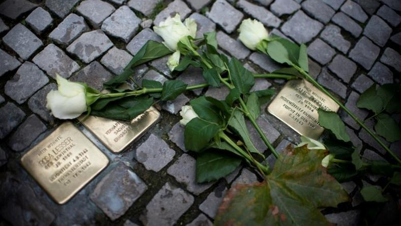 In recent years across Germany on November 9, people have polished brass plaques embedded in pavements bearing the names of Jewish victims