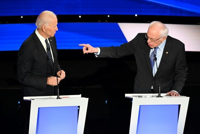 US former vice president Joe Biden (L) and liberal Senator Bernie Sanders were two of the six candidates who clashed during the final Democratic presidential debate before Iowa begins the voting process on February 3, 2020