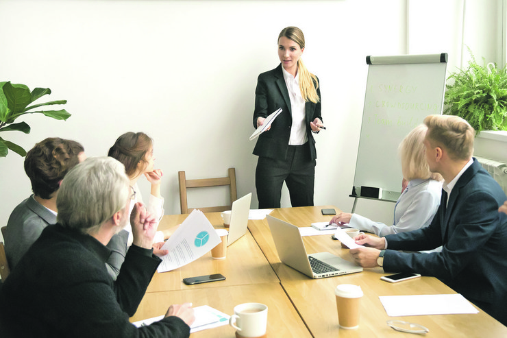 stock-photo-successful-businesswoman-giving-presentation-to-business-team-female-ceo-leader-coaching-teaching-1043108488