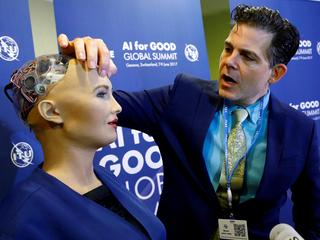"David Hanson of Hanson Robotics presents Sophia, a robot integrating the latest technologies and artificial intelligence is pictured during a presentation at the ""AI for Good"" Global Summit in Geneva"