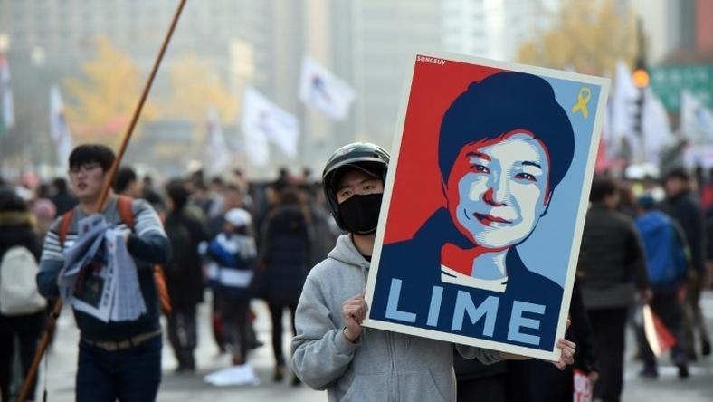 South Korean lawmakers are under pressure to oust President Park Guen-Hye, with mass protests drawing hundreds of thousands across the country