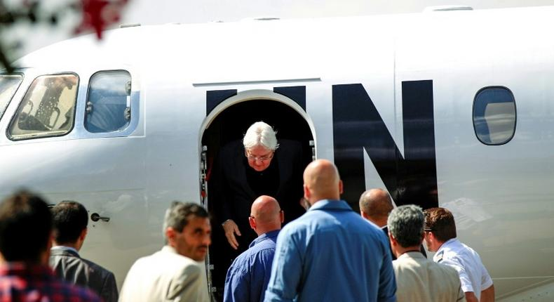 Martin Griffiths (C), the UN special envoy for Yemen, arrives at Sanaa international airport on November 21, 2018