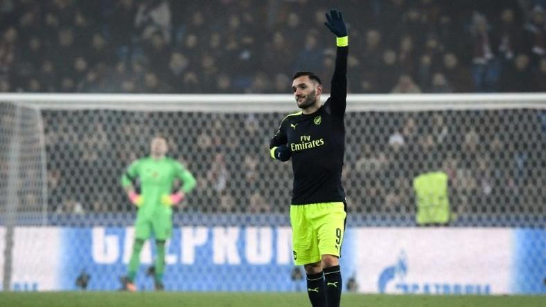 Arsenal's forward Lucas Perez (R) celebrates his third goal during the UEFA Champions league Group A football match between FC Basel 1893 and Arsenal FC on December 6, 2016 at the St Jakob Park stadium in Basel