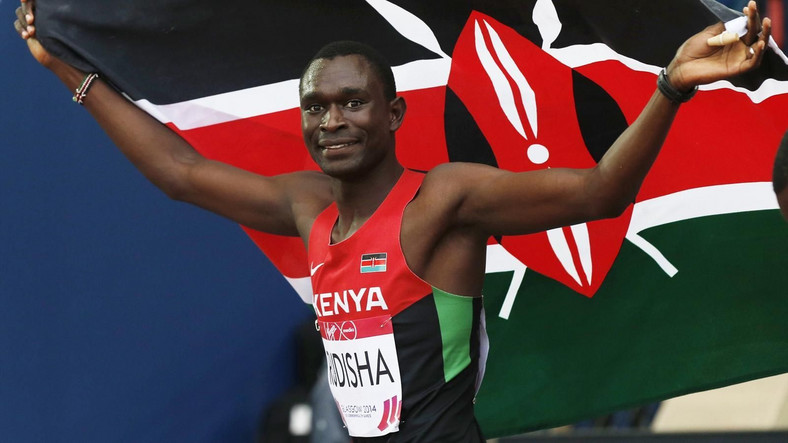 Kenyan athlete David Rudisha with Kenyan flag