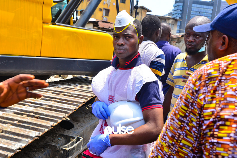A rescue operative at the site of the collapsed building (Pulse)