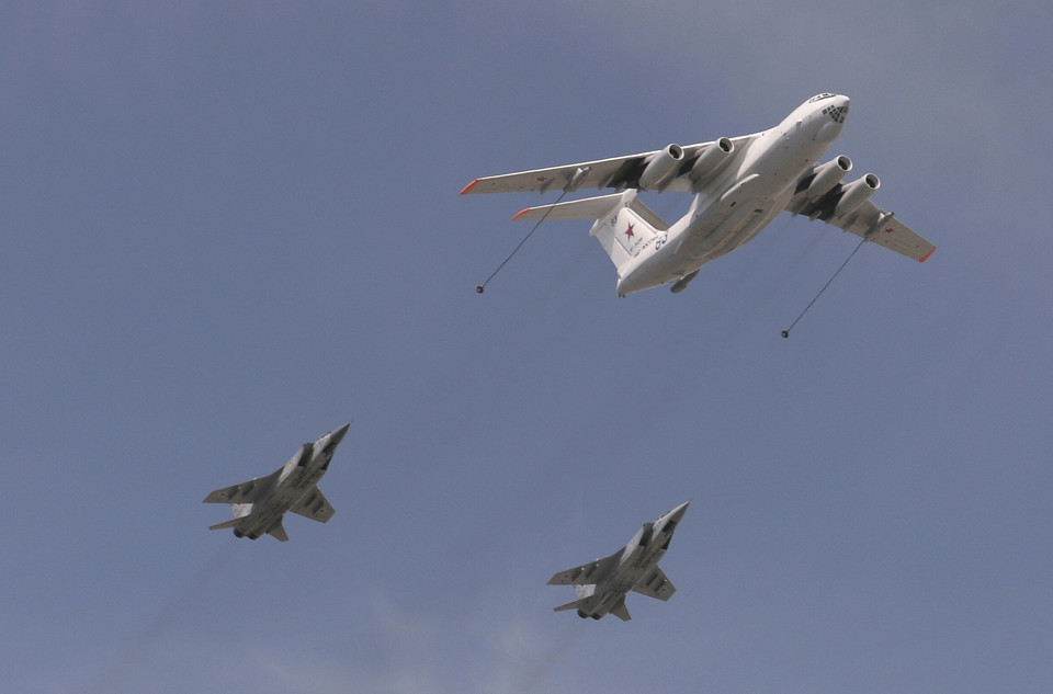 An Ilyushin Il-78 Midas air force tanker and Sukhoi Su-24 Fencer tactical bombers fly over the Red Square during the Victory Day parade in Moscow