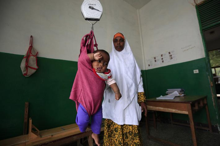 An internally displaced child is weighed at Banadir Hospital in Mogadishu September 28, 2013. Street