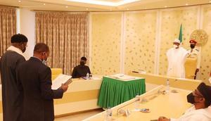 President Muhammadu Buhari swears in Prof Muhammad Sani Kallah (Katsina State) and Professor Kunle Cornelius Ajayi (Ekiti State) as INEC National Commissioners [Presidency]