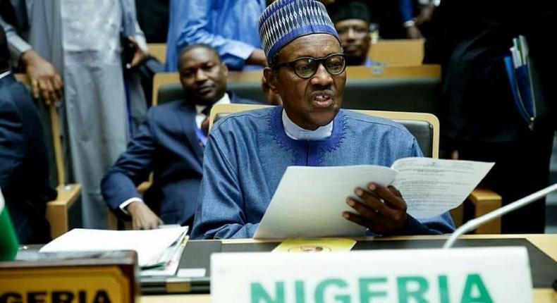 Picture of President Muhammadu Buhari at AU Summit used to illustrate the story (Premium Times)