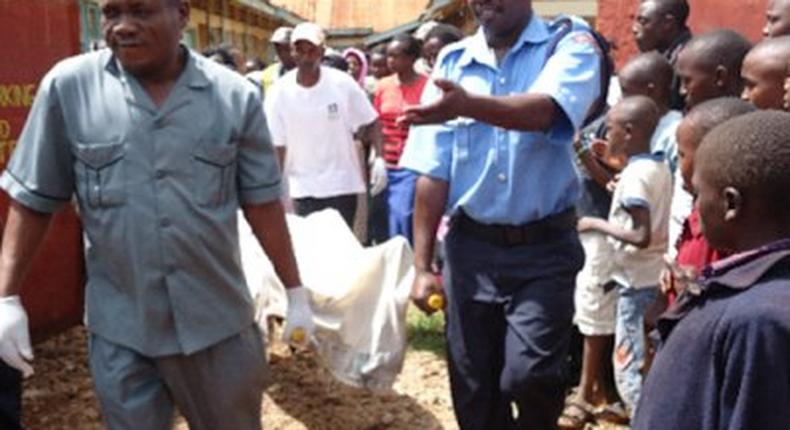 The remains of the deceased being removed by the police