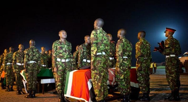 File image of KDF soldiers paying final respects to colleagues who perished in El Adde massacre