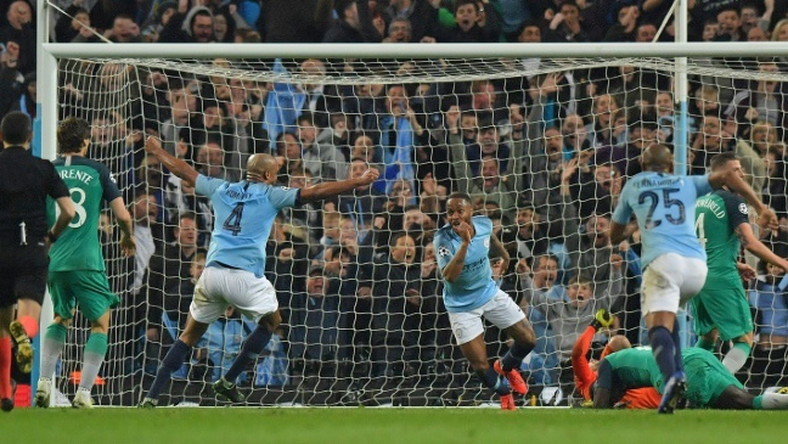 The goal that wasn't: Turkish referee Cuneyt Cakir looks on as Manchester City's Raheem Sterling celebrates scoring -- but the injury-time goal was ruled out by VAR for offside