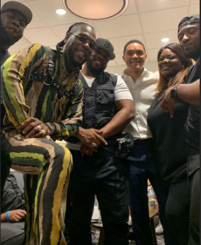 Burna Boy, Trevor Noah and other friends after his performance on 'The Daily Show.' (Instagram/Burnaboygram)