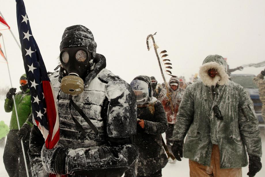 A man takes part in a march with veterans to Backwater Bridge just outside of the Oceti Sakowin camp