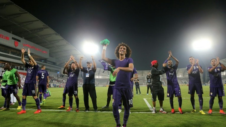 Al-Ain's Omar Abdulrahman (C) and teammates celebrate at the end of their Asian Champions League football match against Qatar's El-Jaish on October 18, 2016 in Doha