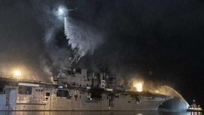 US Navy says it is 'too early to tell' if the badly burnt warship that has been on fire for days can be saved