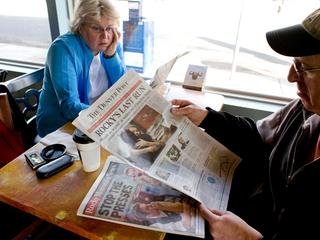 Vicki, left, and Dan Rubin look at the final edition of the