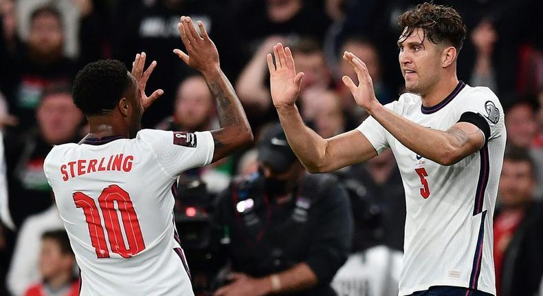 England defender John Stones (R) celebrates with Raheem Sterling Creator: Ben STANSALL