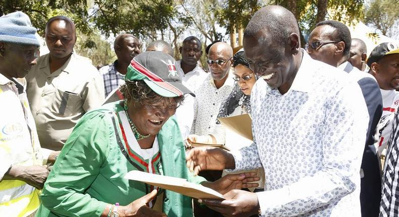 Deputy President William Ruto issues a title deed to one of the locals at Chala Njukini, Taita Taveta County.