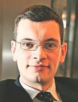 Michał Goj doradca podatkowy i partner w EY